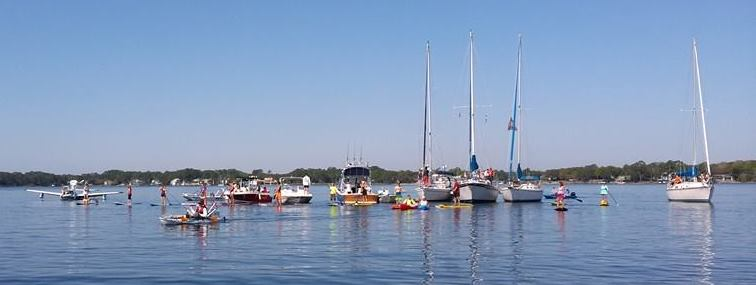 Boats, Paddle Boards, Plane and other vessels lined up for Invasion Photo
